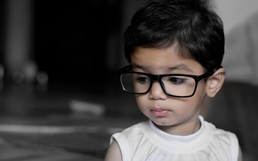 toddler wearing glasses