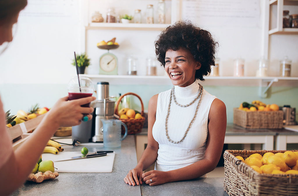 Female smiling behind a counter